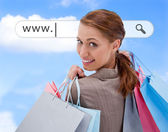 Woman looking over her shoulder with shopping bags under address bar — Stock Photo