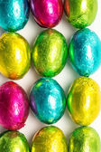 Colourful foil wrapped easter eggs overhead shot — Stock Photo