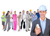 Architect standing in front of different types of workers — Foto Stock
