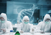 Chemists working in the lab with futuristic interface — Stock Photo