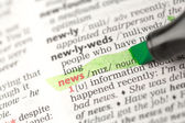 News definition highlighted in green — Stock Photo