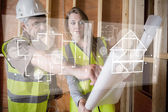 Architect and foreman looking at the plans on interface — Foto Stock