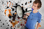 Young man shouting through megaphone — Stock Photo
