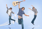 Three of the same teenage boy jumping for joy — Stock Photo