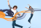Two of the same young man jumping for joy — Stock Photo