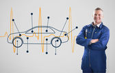 Mechanic standing in front of a background with car — Stock Photo