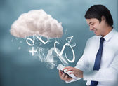 Young businessman connecting to cloud computing — Stock Photo