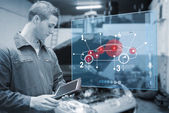 Mechanic using tablet and futuristic interface in black and whit — Stock Photo