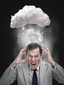 Businessman stressing out under a cloud — Stock Photo