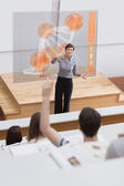 Teacher in front of futuristic interface university college stud — Stock Photo