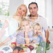 Happy family using futuristic interface to prepare dinner - Photo