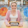 Front view of a student with a tablet looking at futuristics int — Stock Photo #24150079