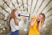 Girl shouting at another through a megaphone — Stok fotoğraf