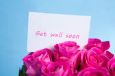 Bouquet of pink roses with get well soon card — Stock Photo