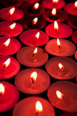 Red candles lighting up the dark — Stock Photo