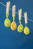 Easter eggs hanging from a washing line — Stock Photo