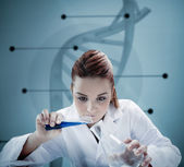 Blonde scientist pouring liquid into erlenmeyer in front of futu — Stock Photo