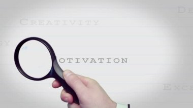 Magnifying glass finding motivating business words — Vidéo