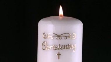 Lit christening candle flickering and going out — Stock Video