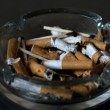 Stock Video: Cigarette falling into ashtray