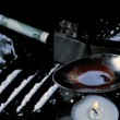 Stock Video: Drugs cooking on spoon with lines racked up and large pile