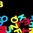 Colourful alphabet forming from pile of letters on black background — Stock Video