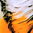 Stock Video: Water whirlpool with orange ink