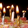 Birthday candles being blown out on a delicious cake close up — Stock Video