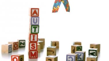 Autism ribbon falling beside blocks spelling autism — Stock Video