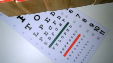 Blocks spelling out sight falling onto eye test — Stock Video