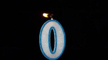 Zero candle flickering and extinguishing on black background — Stock Video