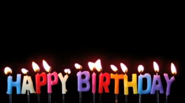 Colourful happy birthday candles being blown out on black background — Stock Video