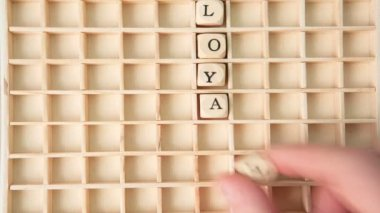 Customer care buzz words spelled out in dice and placed on grid in stop motion — Stock Video