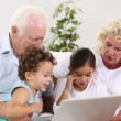 Stock Video: Grandpand granny using tablet with their grandchildren