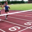 Athletes running towards finish line — Wideo stockowe