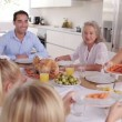 Stock Video: Mother serving carrots to son at family dinner
