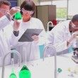 Students doing research in lab — Stock Video #25659927