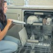 Stock Video: Video of womunloading dishwasher