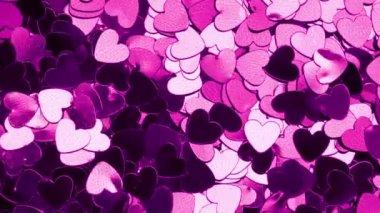 Colore coriandoli a forma di cuore viola — Video Stock