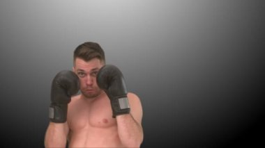 Concentrated man boxing in the air — Stock Video