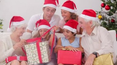 Excited family exchanging gifts at christmas — Stock Video