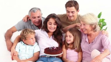 Family blowing candles on chocolate cake — Stock Video