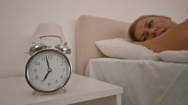 Blond woman pushing the alarm clock — Stock Video
