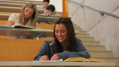 Students learning while exchanging letters — Stock Video