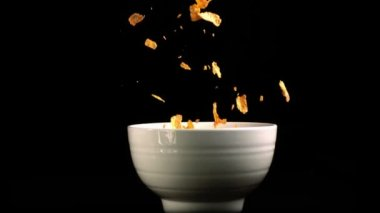 Cereal flakes falling in a bowl — Stock Video