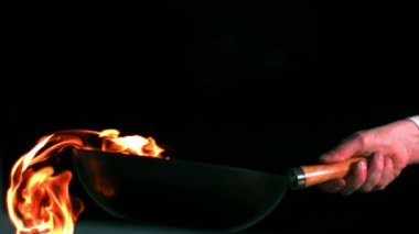 Chef tossing flaming pan of peppers — Stock Video