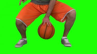 Video of man dribbling basketball against green background — Stock Video