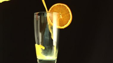 Orange juice pouring into a glass — Wideo stockowe