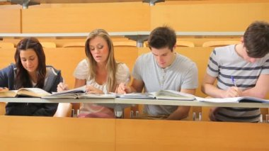 Students sitting at the desk at the lecture hall — Stock Video