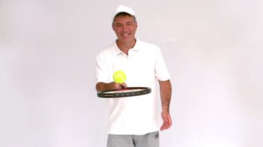 Tennis man juggling with his racket — Stock Video